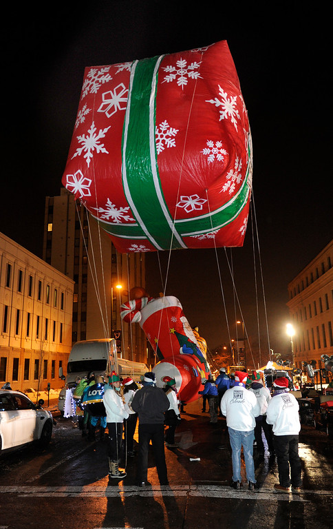 . DENVER, CO. - DECEMBER 06: A giant gift balloon was filled with helium as the 9News Parade of Lights kicked off Friday night, December 6, 2013. The weather was clear but temperatures dipped below zero. Photo By Karl Gehring/The Denver Post