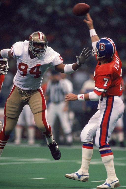 . Defensive end Charles Haley #94 of the San Francisco 49ers pressures Denver Broncos quarterback John Elway #7 in Super Bowl XXIV at Louisiana Superdome on January 28, 1990 in New Orleans, Louisiana.  (Photo by George Rose/Getty Images)