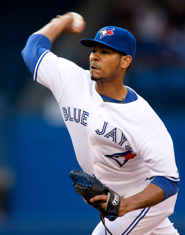 . Toronto Blue Jays starting pitcher Esmil Rogers throws against the Colorado Rockies during first inning of a baseball game in Toronto on Tuesday June 18, 2013. (AP Photo/The Canadian Press, Frank Gunn)