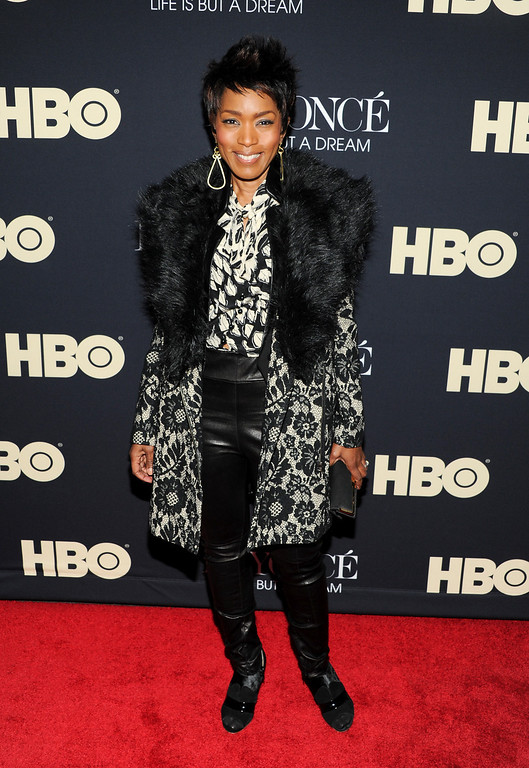 ". Actress Angela Bassett attends the premiere of ""Beyonce: Life Is But A Dream\"" at the Ziegfeld Theatre on Tuesday, Feb. 12, 2013 in New York. (Photo by Evan Agostini/Invision/AP)"