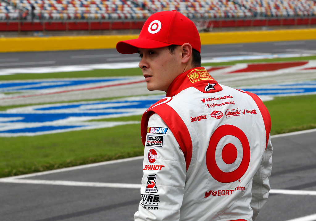 . Kyle Larson looks down pit road after practice for Saturday\'s NASCAR Sprint Cup series auto race at Charlotte Motor Speedway in Concord, N.C., Friday, Oct. 11, 2013. (AP Photo/Terry Renna)