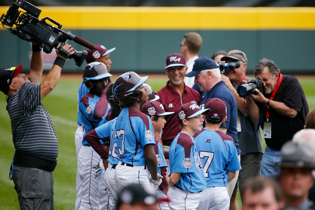 . Philadelphia pitcher Mo\'ne Davis (3) and her teammates are photographed before playing Nashville during a baseball game in U.S. pool play at the Little League World Series tournament in South Williamsport, Pa., Friday, Aug. 15, 2014. Philadelphia won 4-0. (AP Photo/Gene J. Puskar)
