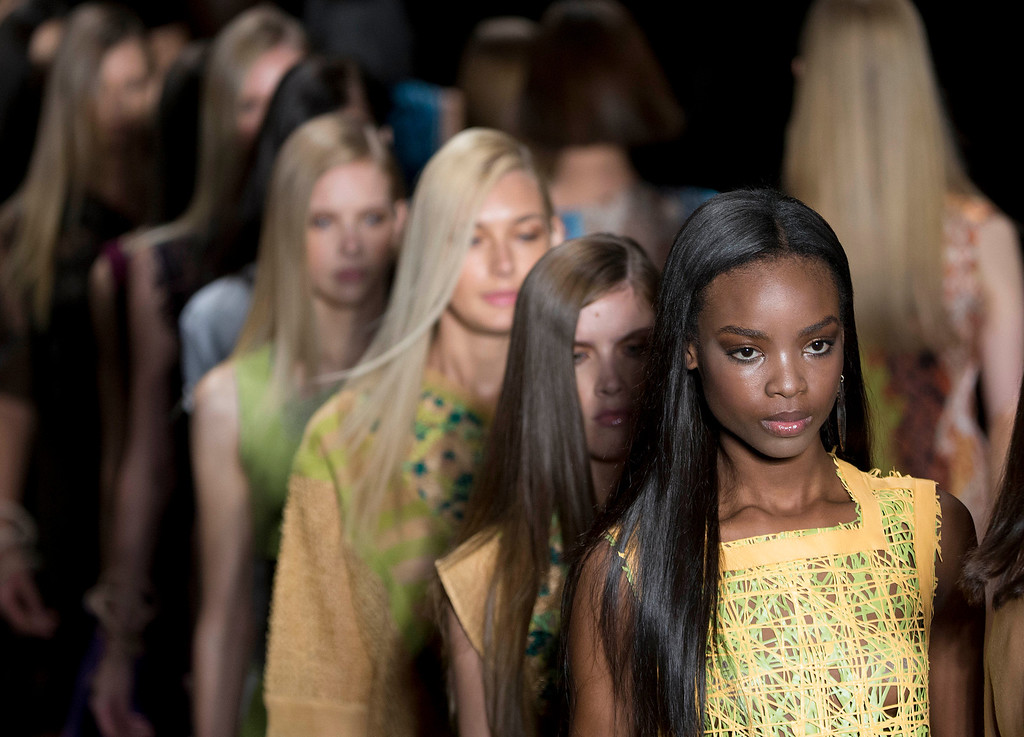 . Angolan Maria Borges in a line of models wearing creations from the Animale Summer collection during the Sao Paulo Fashion Week in Sao Paulo, Brazil, Monday, March 31, 2014. (AP Photo/Andre Penner)