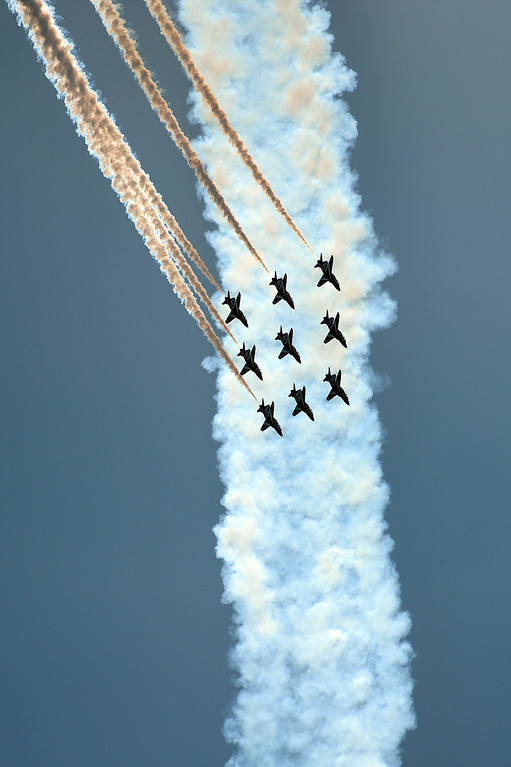. Britain\'s Red Arrows airplane display team perform during D-Day commemorations in Portsmouth in southern England on June 5, 2014. Several hundred surviving veterans of the 1944 D-Day landings are commemorating the 70th anniversary of the mission on both sides of the English channel.  AFP PHOTO / CARL COURT/AFP/Getty Images