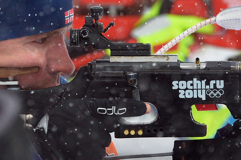 . Norway\'s Emil Hegle Svendsen (9) competes in the second round shoot in the Men\'s Biathlon 15 km Mass Start at the Laura Cross-Country Ski and Biathlon Center during the Sochi Winter Olympics on February 18, 2014, in Rosa Khutor, near Sochi. ALBERTO PIZZOLI/AFP/Getty Images