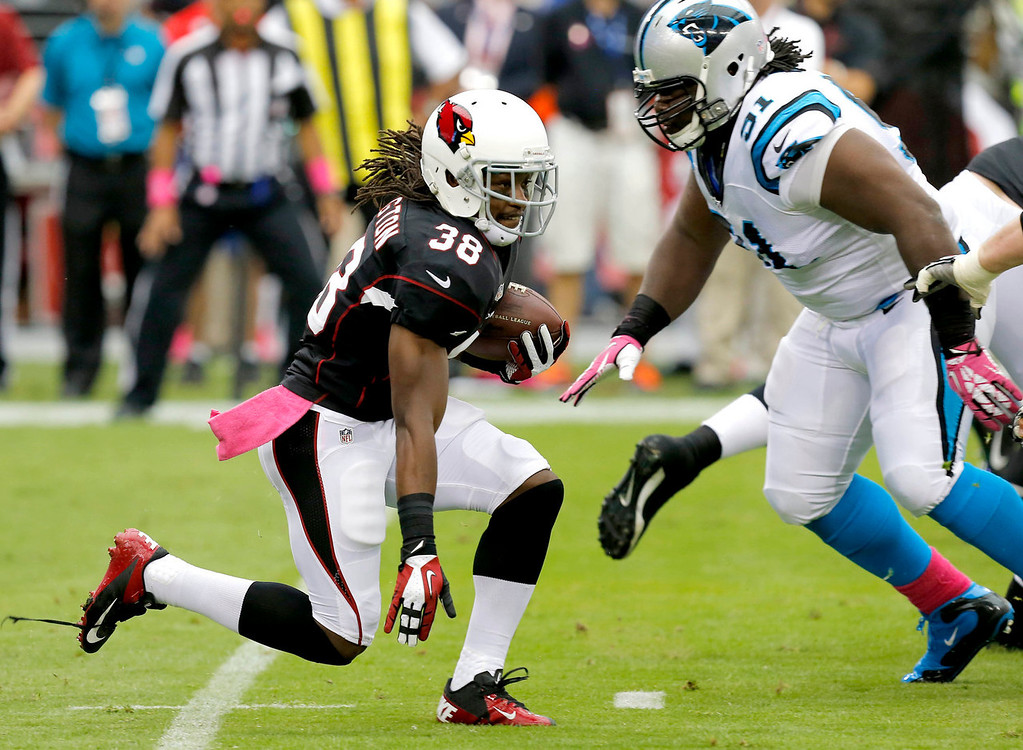 . Arizona Cardinals running back Andre Ellington (38) looks to run as Carolina Panthers defensive tackle Colin Cole (92) defends during the first half of a NFL football game, Sunday, Oct. 6, 2013, in Glendale, Ariz. (AP Photo/Ross D. Franklin)