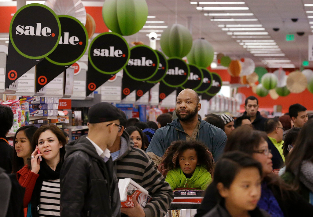 . People shop at a Target store in Colma, Calif., Thursday, Nov. 28, 2013. Instead of waiting for Black Friday, which is typically the year\'s biggest shopping day, more than a dozen major retailers opened on Thanksgiving day this year. (AP Photo/Jeff Chiu)
