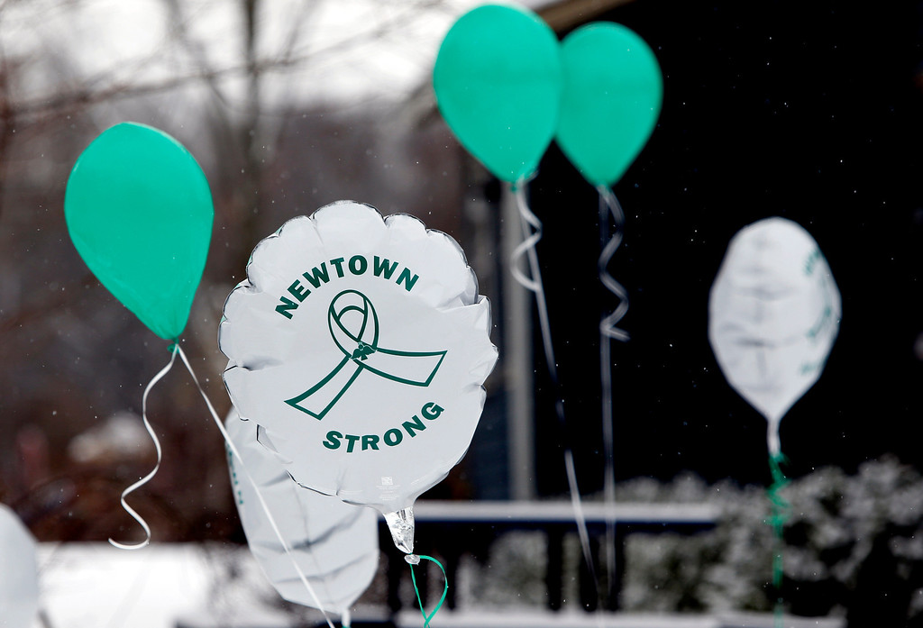. Balloons fly outside a doctor\'s office on the first anniversary of the Sandy Hook massacre, in Newtown, Conn., Saturday, Dec. 14, 2013.   (AP Photo/Robert F. Bukaty)