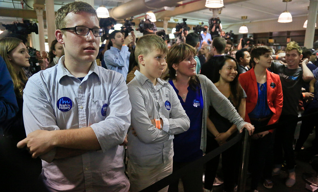 """. Joseph Rodgers, 18, left, a high school senior from Pittsburgh, Pa., wears a \""""I am ready for Hillary\"""" button as he waits to meet HiIlary Clinton at a book signing her new book  \""""Hard Choices,\"""" on Tuesday June 10, 2014, at Barnes and Noble bookstore in New York.   Clinton said Tuesday that she and former President Bill Clinton \""""fully appreciate how hard life is for so many Americans,\"""" seeking to refine remarks she made about the pair being broke when they left the White House while on a high-profile media tour for a new book.  (AP Photo/Bebeto Matthews)"""
