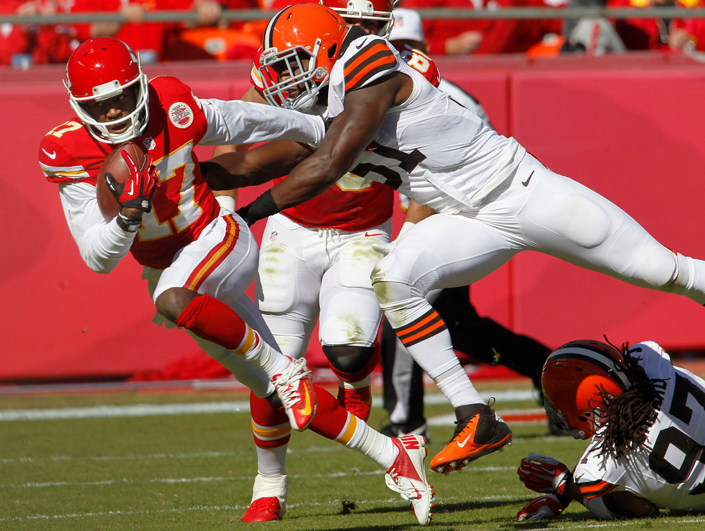 . Kansas City Chiefs wide receiver Donnie Avery (17) is chased down by Cleveland Browns outside linebacker Barkevious Mingo (51) during the first half of an NFL football game in Kansas City, Mo., Sunday, Oct. 27, 2013. (AP Photo/Colin E. Braley)