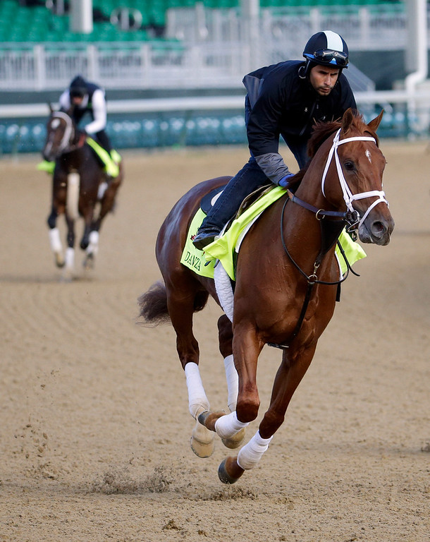 . Exercise rider Ezequiel Perez takes Kentucky Derby entrant Danza for a morning workout at Churchill Downs Thursday, May 1, 2014, in Louisville, Ky. (AP Photo/Morry Gash)