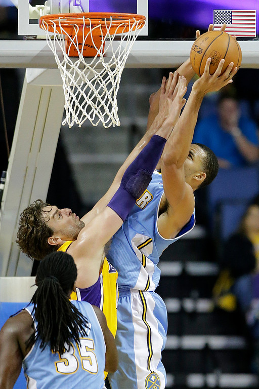 . Denver Nuggets\' JaVale McGee, right, tries for a shot against Los Angeles Lakers\' Pau Gasol, of Spain, in the first half of an NBA preseason basketball game Tuesday, Oct. 8, 2013, in Ontario, Calif. (AP Photo/Jae C. Hong)