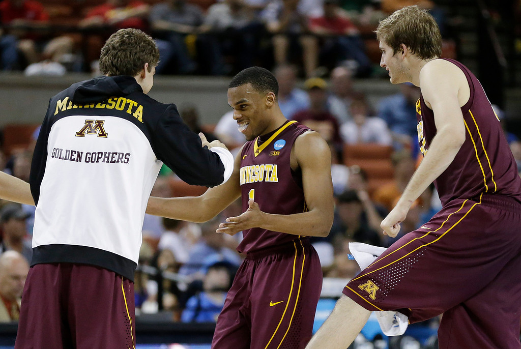 . Minnesota\'s Andre Hollins, center, celebrates with teammates during the second half of a second-round game of the NCAA college basketball tournament Friday, March 22, 2013, in Austin, Texas. Minnesota won 83-63. (AP Photo/Eric Gay)
