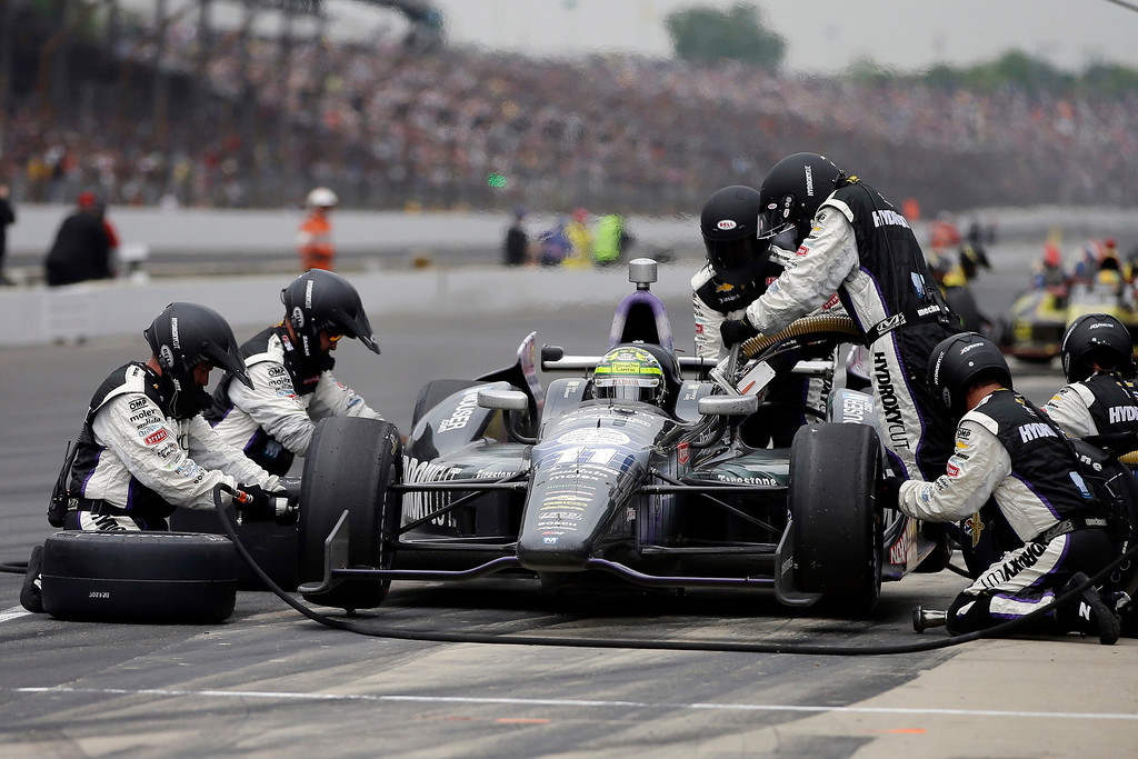 . Tony Kanaan, of Brazil, makes a pit stop during the Indianapolis 500 auto race at the Indianapolis Motor Speedway in Indianapolis Sunday, May 26, 2013. (AP Photo/Darron Cummings)