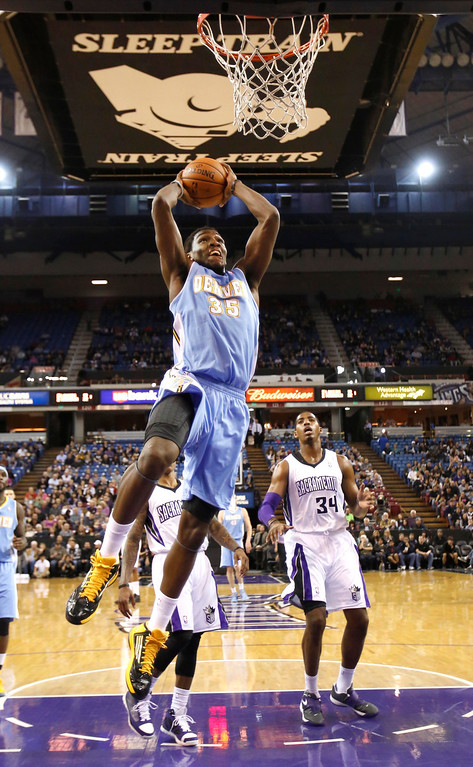 . Denver Nuggets forward Kenneth Faried goes to the basket as Sacramento Kings forward Jason Thompson, right, watches during the first quarter of an NBA basketball game in Sacramento, Calif., Tuesday, March 5, 2013. (AP Photo/Rich Pedroncelli)