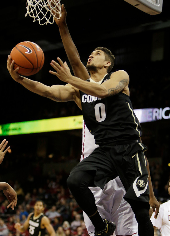 . Coloradoís Askia Booker (0) attempts a layup during the second half of an NCAA college basketball game against Washington State on Wednesday, Jan. 8, 2014, in Spokane, Wash. Colorado won 71-70 in overtime. (AP Photo/Young Kwak)