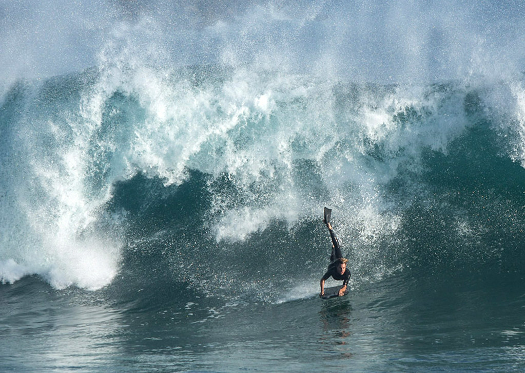 . In this Tuesday, Aug. 26, 2014 photo, a belly boarder takes on a big wave at the Wedge in Newport Beach, Calif. Southern California coastal communities have been inundated by a surge of rising seawater brought on by Hurricane Marie spinning off Mexico\'s Pacific coast. (AP Photo/Kevin Warn)