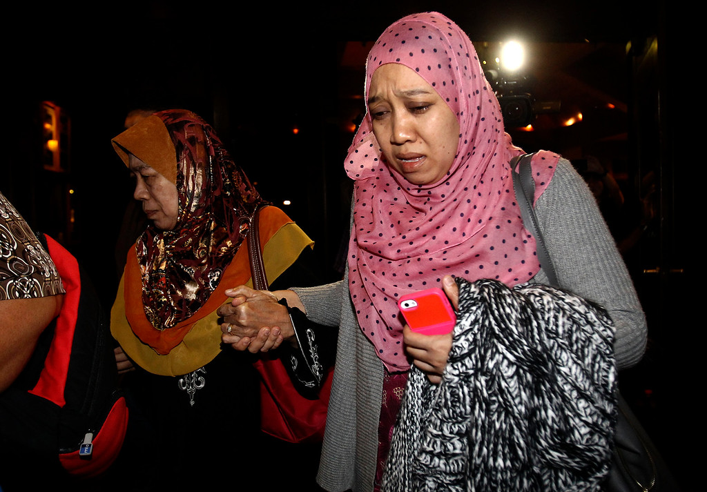 . Family members of passengers aboard a missing Malaysia Airlines plane arrive for a briefing at a resort in Cyberjaya, Malaysia, Thursday, March 20, 2014. Military search planes flew over a remote part of the Indian Ocean on Thursday hunting for debris in ìprobably the best leadî so far in finding the missing Malaysia Airlines flight, officials said. (AP Photo/Lai Seng Sin)