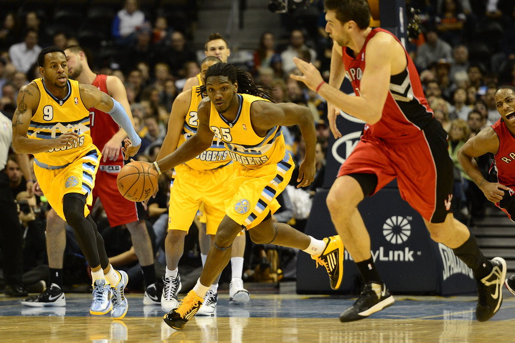 . Denver Nuggets forward Kenneth Faried makes a steal during the first half against the Toronto Raptors at the Pepsi Center on Monday, December 3, 2012. AAron Ontiveroz/The Denver Post