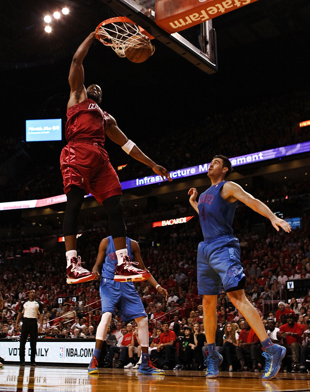 . MIAMI, FL - DECEMBER 25: Dwyane Wade #3 of the Miami Heat dunks against Nick Collison #4 of the Oklahoma City Thunder at AmericanAirlines Arena on December 25, 2012 in Miami, Florida. The Heat defeated the Thunder 103-97.  (Photo by Marc Serota/Getty Images)