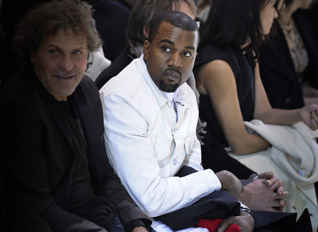 . Kanye West, centre, attends the fashion designer Martin Margiela\'s Spring/Summer 2013 Haute Couture fashion collection, in Paris, Wednesday, Jan. 23, 2013. (AP Photo/Zacharie Scheurer)