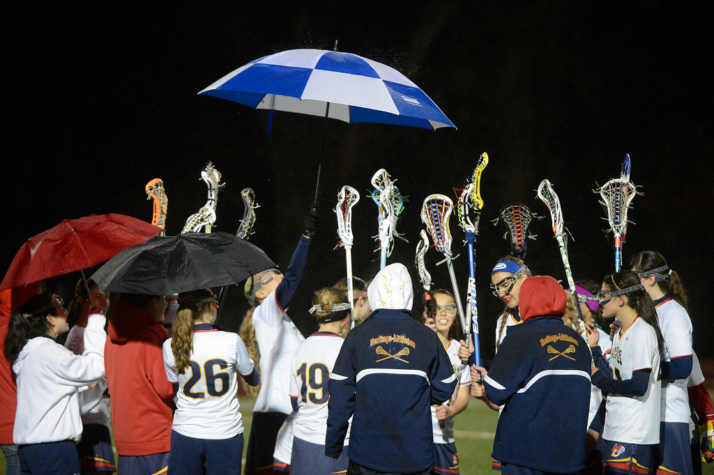 . LITTLETON, CO - MAY 8: Heritage/Littleton girls lacrosse team during a time-out during the second half of play against ThunderRidge High School at Littleton Public Schools Stadium for the first round of the 2013 Colorado Girls State Lacrosse Championships May 8, 2013. ThunderRidge won 8-5. (Photo By Andy Cross/The Denver Post)