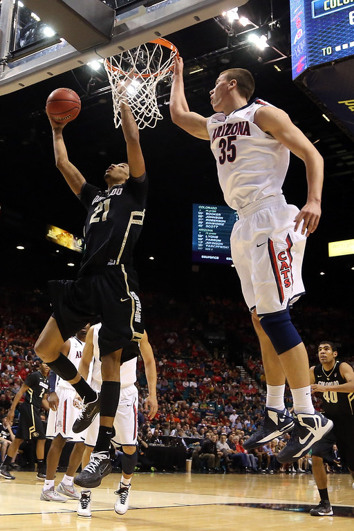 . Andre Roberson #21 of the Colorado Buffaloes goes up for a shot against Kaleb Tarczewski #35 of the Arizona Wildcats in the first half during the quarterfinals of the Pac-12 tournament at the MGM Grand Garden Arena on March 14, 2013 in Las Vegas, Nevada.  (Photo by Jeff Gross/Getty Images)