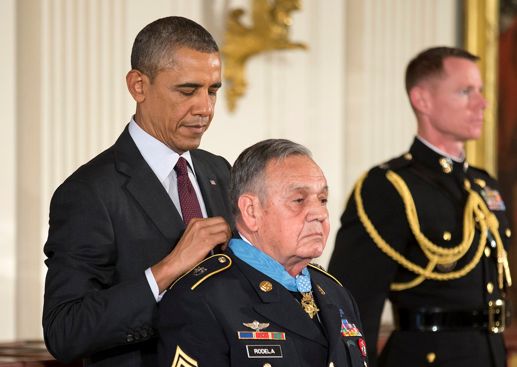 . President Barack Obama awards Army Sgt. 1st Class Jose Rodela the Medal of Honor, at a ceremony in the East Room  of the White House in Washington, Tuesday, March 18, 2014.   (AP Photo/Manuel Balce Ceneta)