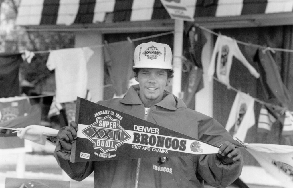 . 1-1988 - 25th and Federal. William Walters holds up a Penant of Denver Broncos. (Glen Martin/The Denver Post)
