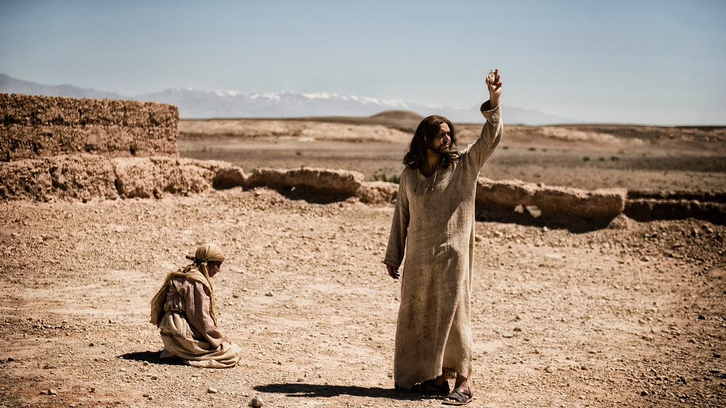 """. \""""The Bible\"""" - Exterior Galilee Village; A woman is about to be stoned and Jesus (DIOGO MORCALDO) confronts Simon (PAUL MARC DAVIS) and the Pharisees. © Lightworkers Media / Hearst Productions Inc."""