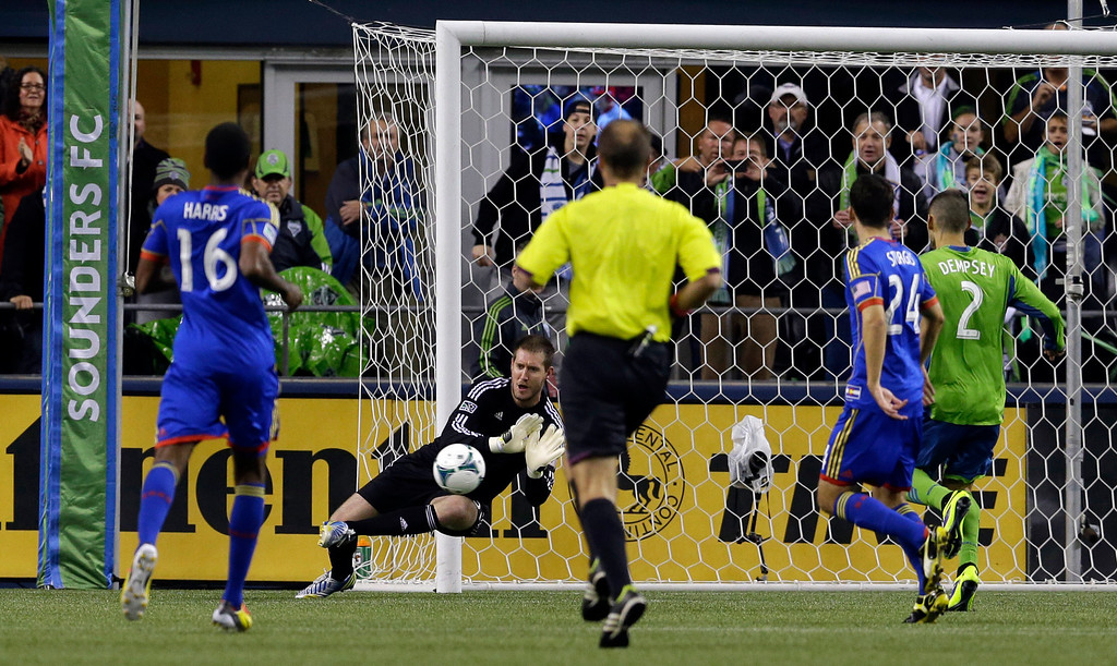 . Colorado Rapids goalkeeper Clint Irwin, second from left, makes a save in the first half of a knockout-round match against the Seattle Sounders in the MLS Cup soccer playoffs Wednesday, Oct. 30, 2013, in Seattle. (AP Photo/Ted S. Warren)
