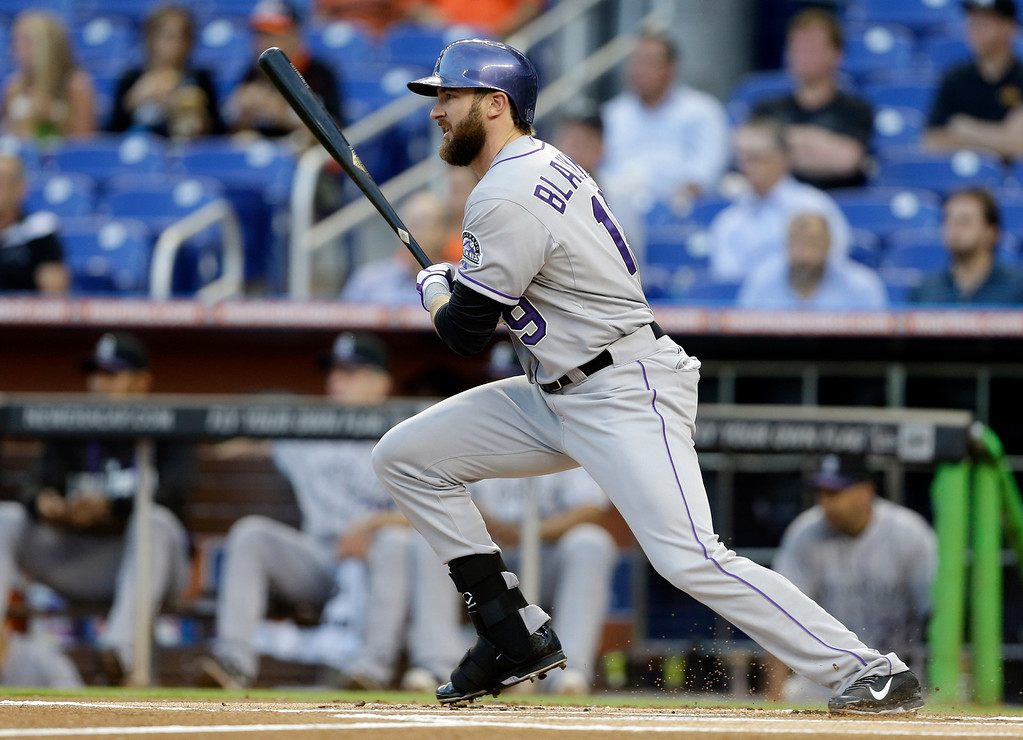 . Colorado Rockies\' Charlie Blackmon watches after hitting a single in the first inning of a baseball game against the Miami Marlins, Wednesday, April 2, 2014, in Miami. (AP Photo/Lynne Sladky)