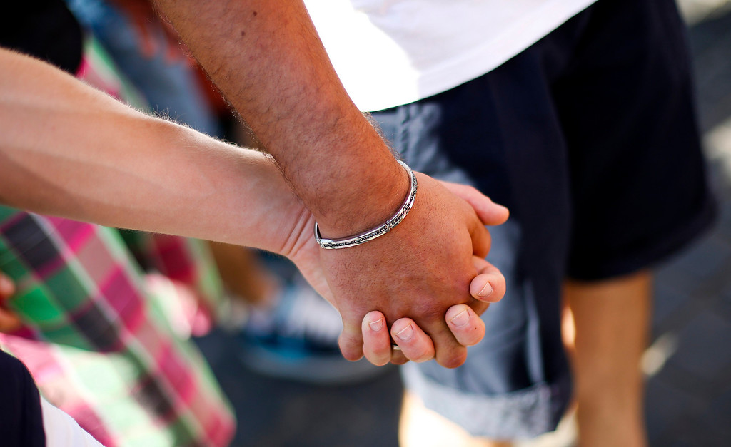 . A gay couple hold hands during the annual gay pride parade in downtown Rome June 15, 2013. REUTERS/Max Rossi