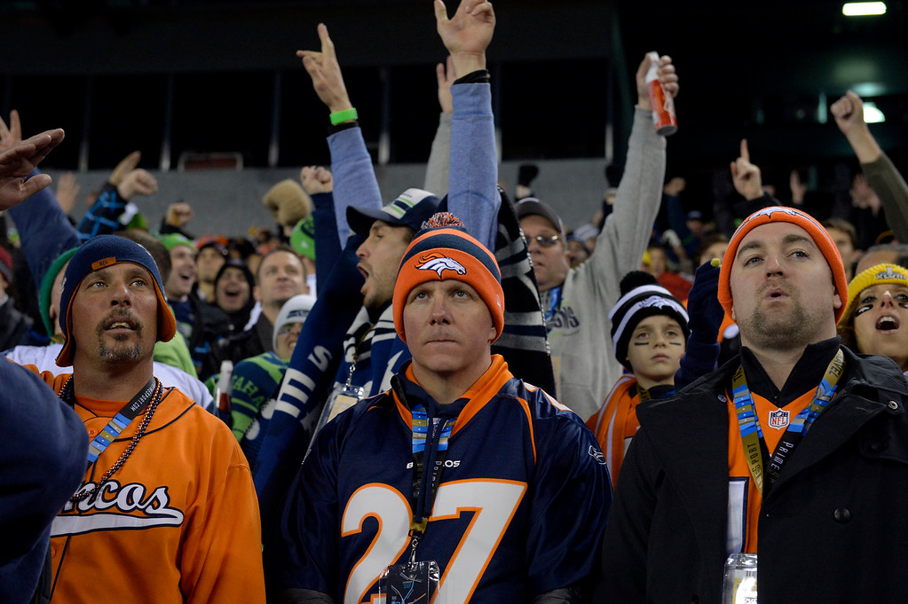 . L to R - Bob Wise of Loveland, CO, Derek Doke of Alberta, Canada, and Richard Dixon also of Alberta, Canada watch the Denver Broncos lose to the Seattle Seahawks.  The Denver Broncos vs the Seattle Seahawks in Super Bowl XLVIII at MetLife Stadium in East Rutherford, New Jersey Sunday, February 2, 2014. (Photo by Craig F. Walker/The Denver Post)