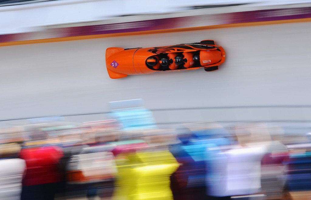 . Pilot Edwin van Calker, Bror van der Zijde, Sybren Jansma and Arno Klaassen of the Netherlands team 1 make a run during the Men\'s Four-Man Bobsleigh on Day 16 of the Sochi 2014 Winter Olympics at Sliding Center Sanki on February 23, 2014 in Sochi, Russia.  (Photo by Lars Baron/Getty Images)