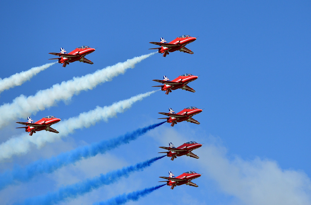 . The Red Arrows perform a flypast to formally open the Farnborough air show in Hampshire, England, on July 14, 2014. The biennial event sees leading companies from the aviation industry showcase their latest technology. AFP PHOTO / CARL COURT/AFP/Getty Images