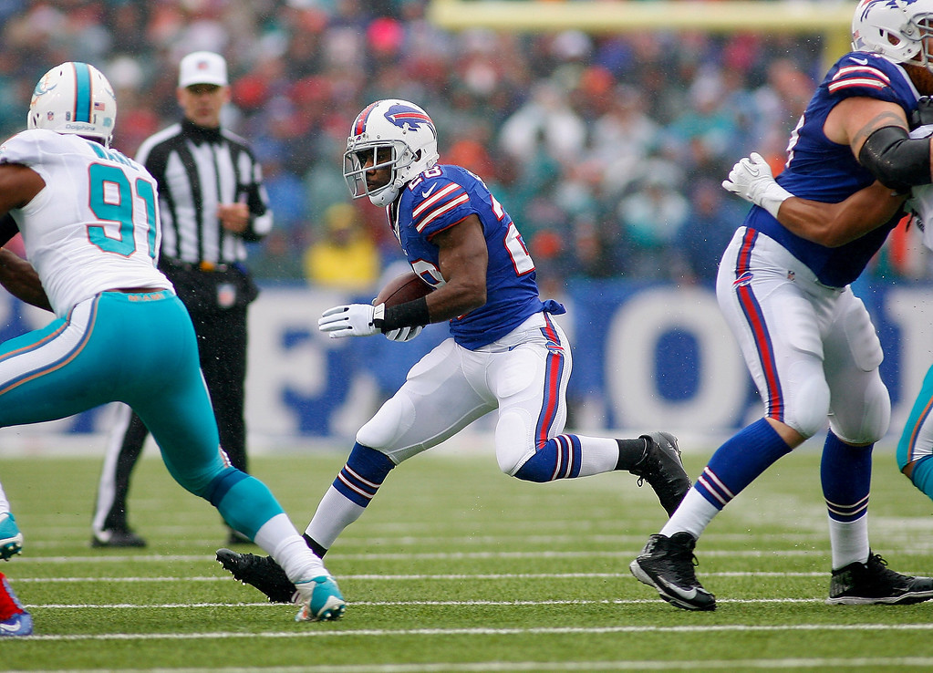 . C.J. Spiller #28 of the Buffalo Bills runs against the Miami Dolphins at Ralph Wilson Stadium on December 22, 2013 in Orchard Park, New York.  (Photo by Rick Stewart/Getty Images)