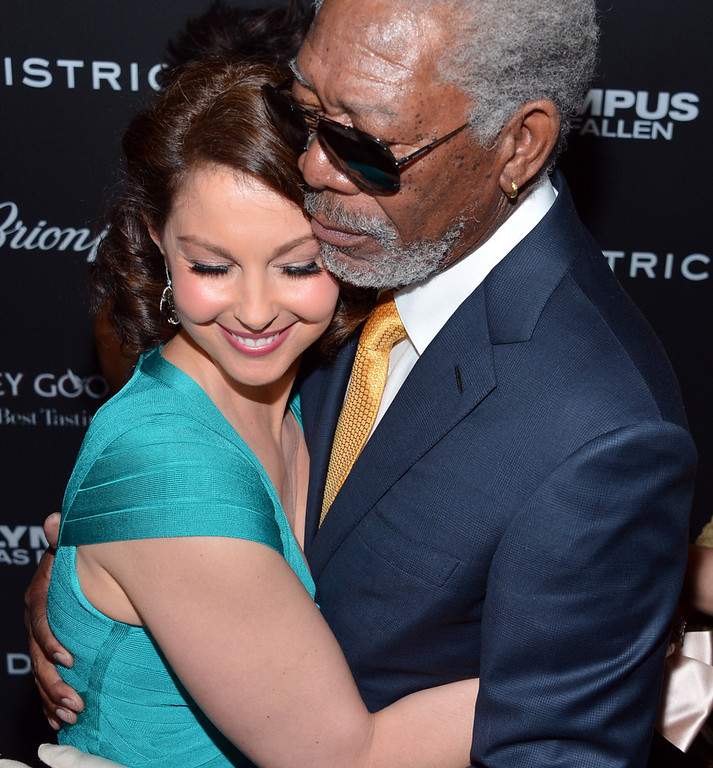 """. Actors Ashley Judd (L) and Morgan Freeman arrive at the premiere of FilmDistrict\'s \""""Olympus Has Fallen\"""" at ArcLight Cinemas Cinerama Dome on March 18, 2013 in Hollywood, California.  (Photo by Alberto E. Rodriguez/Getty Images)"""
