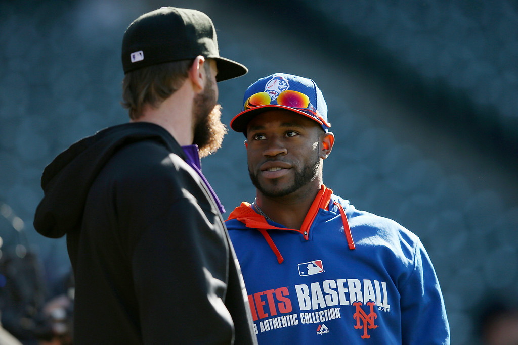 . (L-R) Charlie Blackmon #19 of the Colorado Rockies and Eric Young Jr. #22 of the New York Mets talk during batting practice prior to their game at Coors Field on May 1, 2014 in Denver, Colorado.  (Photo by Doug Pensinger/Getty Images)