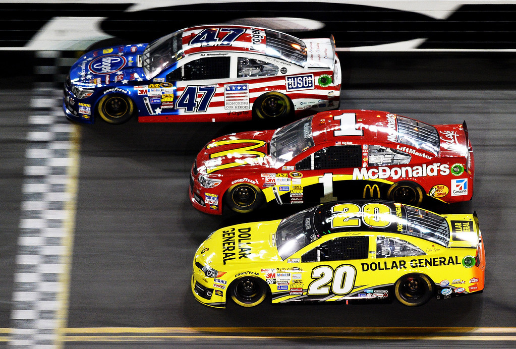 . Matt Kenseth, driver of the #20 Dollar General Toyota, Jamie McMurray, driver of the #1 McDonald\'s Chevrolet, and AJ Allmendinger, driver of the #47 Kroger/USO Chevrolet, race during the NASCAR Sprint Cup Series Daytona 500 at Daytona International Speedway on February 23, 2014 in Daytona Beach, Florida.  (Photo by Jared C. Tilton/Getty Images)