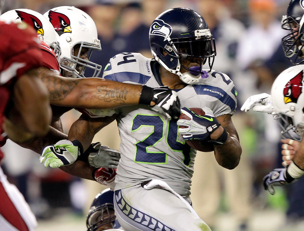 . Seattle Seahawks running back Marshawn Lynch (24) runs against the Arizona Cardinals during the first half of an NFL football game, Thursday, Oct. 17, 2013, in Glendale, Ariz. (AP Photo/Rick Scuteri)