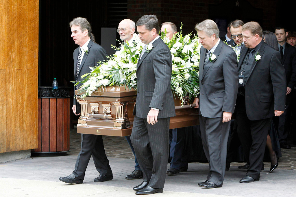 . Pallbearers carry country music legend George Jones to the hearse during a public memorial service at the Grand Ole Opry House in Nashville, Tennessee, May 2, 2013. REUTERS/Harrison McClary