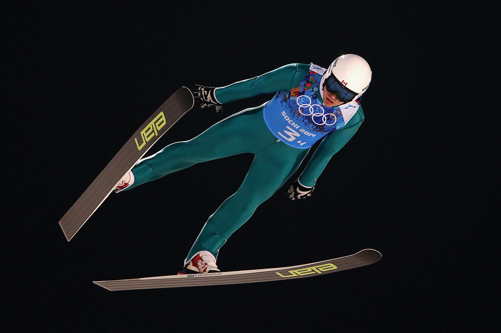 . Mackenzie Boyd-Clowes of Canada jumps during the Men\'s Team Ski Jumping trial on day 10 of the Sochi 2014 Winter Olympics at the RusSki Gorki Ski Jumping Center on February 17, 2014 in Sochi, Russia.  (Photo by Paul Gilham/Getty Images)