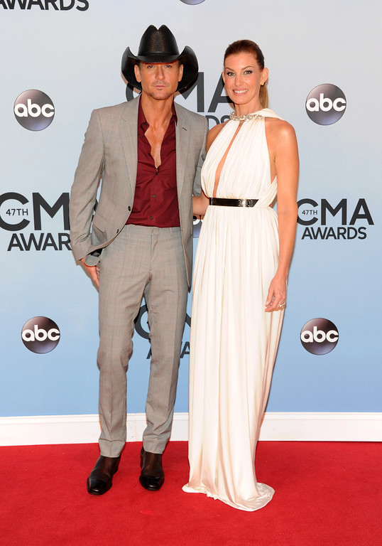 . Tim McGraw, left, and Faith Hill arrive at the 47th annual CMA Awards at Bridgestone Arena on Wednesday, Nov. 6, 2013, in Nashville, Tenn. (Photo by Evan Agostini/Invision/AP)
