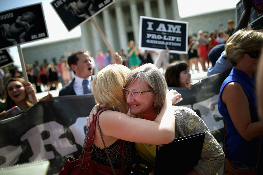 . Anti-abortion advocates cheer in front of the Supreme Court after the decision in Burwell v. Hobby Lobby Stores was announced June 30, 2014 in Washington, DC. (Photo by Chip Somodevilla/Getty Images)