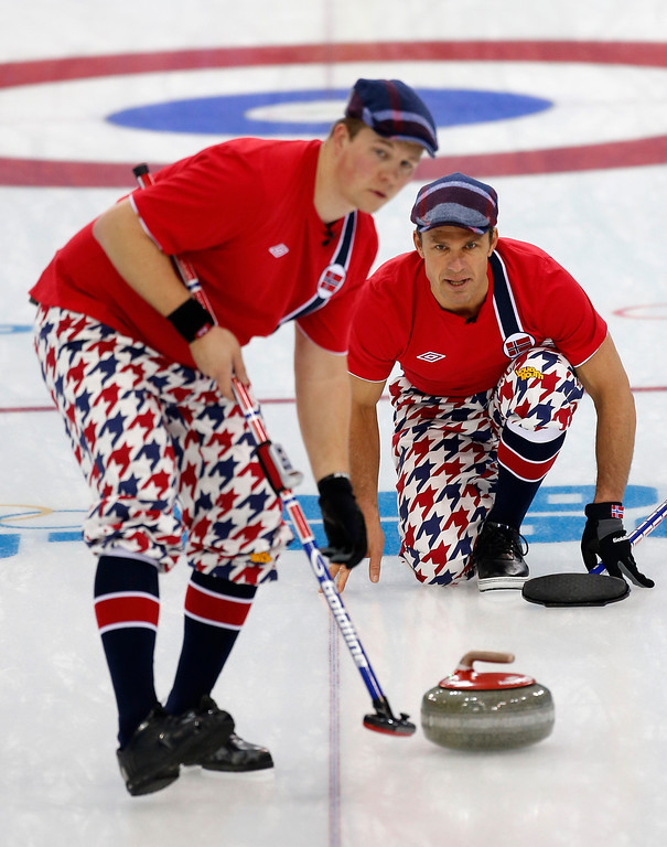 . Norway\'s skip Thomas Ulsrud, right, instructs sweeper Christoffer Svae after delivering the rock during men\'s curling competition against Germany at the 2014 Winter Olympics, Wednesday, Feb. 12, 2014, in Sochi, Russia. (AP Photo/Robert F. Bukaty)
