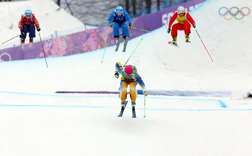 . Sandra Naeslund of Sweden leads (from left) Kelsey Serwa of Canada, Katrin Ofner of Austria and Fanny Smith of Switzerland in the semi final of the women\'s Freestyle Ski Cross event in Rosa Khutor Extreme Park at the Sochi 2014 Olympic Games, Krasnaya Polyana, Russia, 21 February 2014.  EPA/JENS BUETTNER