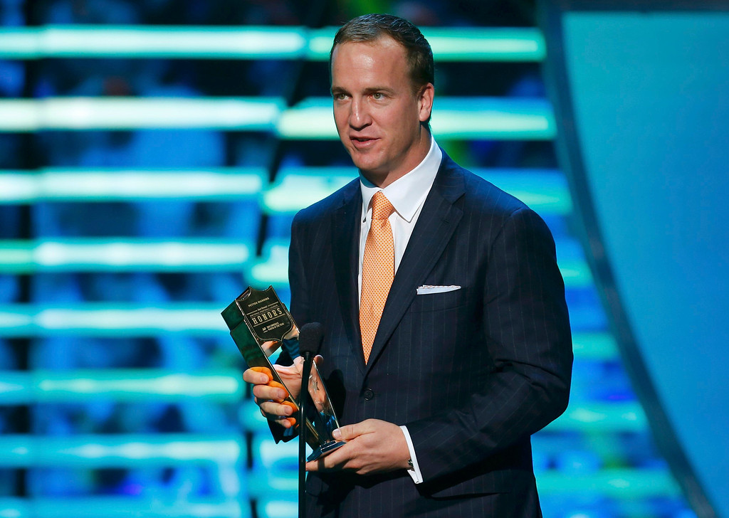 . Denver Broncos quarterback Peyton Manning accepts the NFL Comeback Player of the Year award during the NFL Honors award show in New Orleans, Louisiana February 2, 2013.     REUTERS/Jeff Haynes