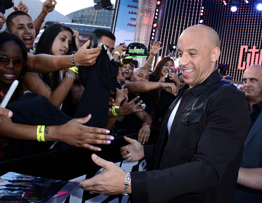 """. Actor Vin Diesel arrives at the LA Premiere of the \""""Fast & Furious 6\"""" at the Gibson Amphitheatre on Tuesday, May 21, 2013 in Universal City, Calif. (Photo by Dan Steinberg/Invision/AP)"""