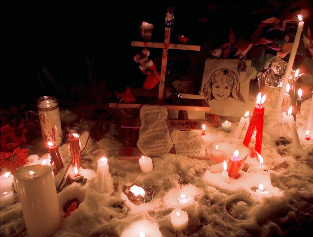 . Candles surround a portrait of JonBenet Ramsey outside her home after a candlelight vigil on the one-year anniversary of her murder Friday, Dec. 26, 1997, in Boulder, Colo. About 60 people gathered for the vigil. (AP Photo/Michael S. Green)
